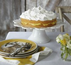 Lemon Curd Layer Cake/ Lemon Curd Layer Cake   5 eggs 3/4 cup sugar 3/4 tsp. lemon extract 1 cup cake flour, sifted 4 Tbs. (1/2 stick) unsalted butter, melted and cooled to room temperature 1 1/2 cups lemon curd 3 cups lightly sweetened whipped cream (made from 1 1/2 cups heavy cream) Assorted fresh berries for serving (optional)