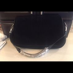 Yve Saint Laurent Mombosa Bag 100% Authentic Yves Saint Laurent Mombasa Bag. Black suede and leather trim Mombosa Bag w Silvertone hardware, detachable strap, suede lining with dual compartment with double snap closure at top. Very good condition! Own this beautiful look for a fraction of the price!!! Yves Saint Laurent Bags