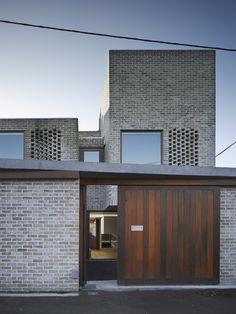 GRAY brick with rich wood. Waterloo Lane / Grafton Architects