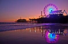 LED lights glow on the Santa Monica ferris wheel, which is running on solar power (the first in the country).