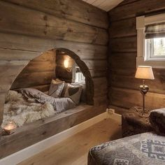 cozy arched wood log nook with window