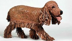 A series of dog related sculptures, all made from old bike chains, by artist Nirit Levav Packer.