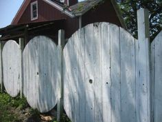 recycling wood spools | Tops and bottoms of large spools used as fence panels with posts ...