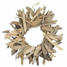 Beautiful pieces of driftwood made into a wreath.. Includes rope for hanging or you can just place it against your wall. 18 inches in diameter.