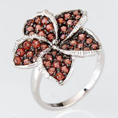 Take a fashion getaway every time you look at this amazing flower ring! It's the perfect little piece for your upcoming escape to those warm beaches! || 1.52ctw Round Garnet Sterling Silver Ring [Promotional Pin]