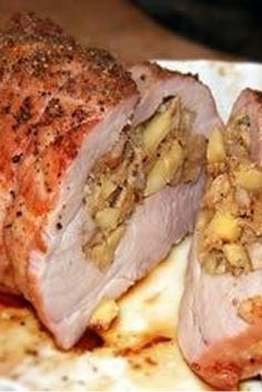 An apple-walnut-breadcrumb stuffing is wrapped inside a pork roast, making an easy to cook and serve meal.
