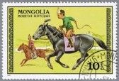 MONGOLIA - CIRCA 1977: A stamp printed in Mongolia shows the boys on horseback, a series devoted to horses.