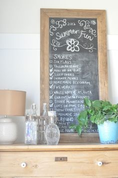 chalkboard with a checklist of things to do each season... cute!