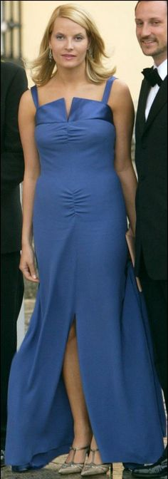 Crown Princess Mette-Marit of Norway in a blue Valentino dress at the pre-wedding dinner on May 21; wedding of Prince Felipe of the Asturias and ms. Letizia Ortiz on May 22, 2004