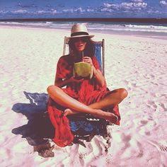 Chillin' in the sun with some coconut water on the #beach in Bermuda. Another day living the good life!  Posted by #planetblue on #4thofjuly