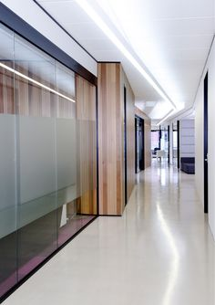 Corridor with suspended continuous profile strip light.