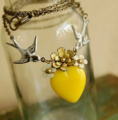 Vintage enamel flower and yellow glass heart necklace on brass chain
