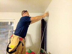 Del Rio Fire and Rescue firefighter installs a in home visual fire alarm for the hearing impaired. Alarms were purchased through fund-raising and help from the Del Rio Professional Firefighters Association Local 3662.