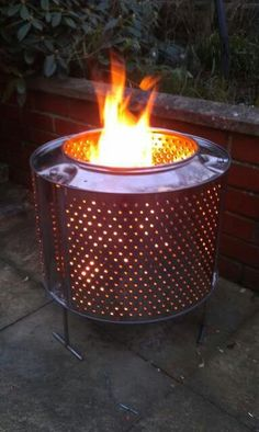 Washing machine drum as a fire pit..can put on bricks or an old tire rim