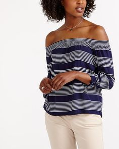 "Want to stand out from the crowd? This Striped Off The Shoulder Blouse will show you the way. Embellished with decorative bows at the bottom of the sleeves, it features an elasticized neckline. Pair it with capris or ankle pants for a summery look.<br /><br />Length: 24""<br /><br />Ready to wear for: the office, a lunch date or a 5 à 7"