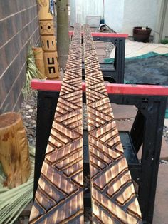 tiki carving crown moulding.  Painted this pattern on the kickboard in the tiki bar