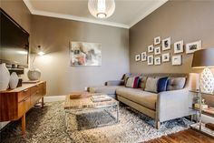 Transitional Living Room with High ceiling, Carpet, flush light, West Elm Crosby 2-Piece Chaise Sectional, Hardwood floors