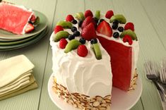 Watermelon 'Cake' Recipe  1 whole  seedless watermelon (6 lb.) 1 tub  (8 oz.) COOL WHIP Whipped Topping, thawed 1 cup  PLANTERS Sliced Almonds 1 kiwi, cut lengthwise in half, then sliced crosswise 3 strawberries, hulled 1/3 cup  raspberries 1/4 cup  blueberries