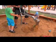 Bagr na písek - baby playing with a digger in the sand - YouTube