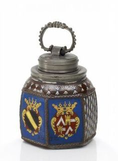 A German screw-top stoneware bottle, 1652, enamelled with the coat of arms of the Heberstein family. (Van Ham)