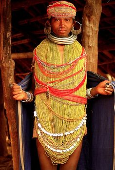 a tribal woman…in her traditional wear…  women wear one cloth under waist……the upper body is covered by this traditional jewellery……  by Sanzen