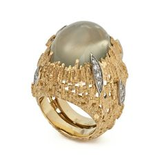Moonstone Ring, 2013 - A cabochon Moonstone set in Yellow Gold textured wire surrounded by pave-set Diamonds