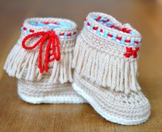 Crochet Baby shoes pattern for native American inspired booties with fringe and side ties inspired by the beauty of Navajo design. These little cuties are right on trend and just the thing for the festive season - the ideal Christmas gift - unique and individual - you won't see anything like these anywhere else! Make them in Red, or silver grey for a really festive look.