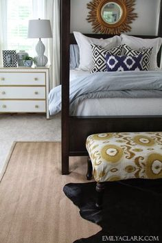 Decorating with a cowhide rug in the bedroom:  http://emilyaclark.com/2013/10/a-cowhide-rug-for-our-bedroom.html