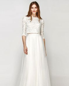 Are you a low-key, no fuss, gorgeous boho bride? This combo by Willow by Watters will have you feeling beautiful on your big day. Lace crop top wedding dress with flowy tulle skirt.