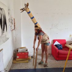 imaginative way to be a giraffe! G is for giraffe from a bunch of studio trash. Made by Abby Manock.