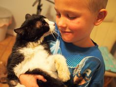 Little Boy Gave This 'Ancient' Cat The Best Life