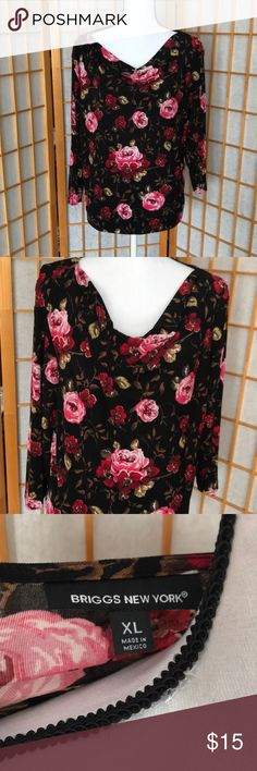 "Briggs New York Blouse Size XL Rose designed blouse with lots of stretch. It is a Polyester spandex blend with 3/4 sleeves. Armpit to Armpit is 23"", Length is 23"". New York Briggs Tops Blouses"