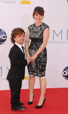 Peter Dinklage and Erica Schmidt arrive at the 64th Primetime Emmy Awards at Nokia Theatre LA Live on September 23 2012 in Los Angeles California