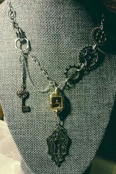 Vintage watch case necklace with large key plate #steampunk #jewerly #imadethis