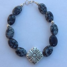 30% Off Bundles Natural Snowflake Obsidian Let it snow with these gorgeous snowflake stone 😊 with antique silver plated in the middle with sterling silver clasp. Cindylou's Design Jewelry