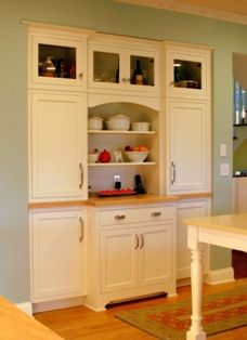 This built-in hutch replaces the pantry and serves as food storage