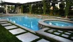 rectangular pool with circular spa and concrete stepping stairs around