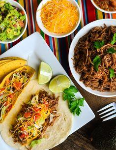 Crock pot brisket tacos | www.thespicekitrecipes.com | #crockpot #tacos #recipe