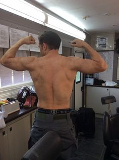 Tom Hardy flexing his muscles shirtless... Omg. Thanks for the instant orgasm, Tommy. - June 2014  After full tattoo coverup