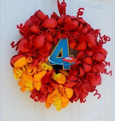 Rocket balloon wreath at a Little Einstein's birthday party! See more party planning ideas at CatchMyParty.com!