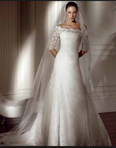 Lace sleeves cover ground shoulders open