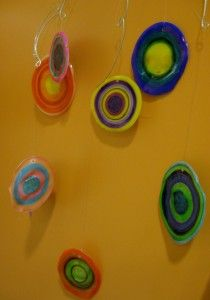 Kandinsky-inspired mobile: paint clear plastic cups with sharpies then bake . Anybody who knows me and my unfortunate taco shell incidents would not allow me to bake plastic cups.