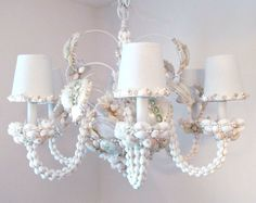 Check out this item in my Etsy shop https://www.etsy.com/listing/247500767/seashell-chandelier-chandelier-lighting
