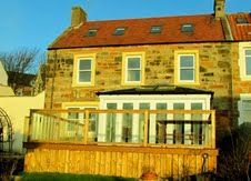 Ivy Bank a traditional sandstone style house with four bedrooms, WiFi and a flat screen TV. This property is of a modern style upon a traditional setting, which is perfectly located in St Monans.