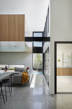 This modern day bungalow has the ultimate selection of contemporary materials - monochrome walls and doors, concrete, red brick and blonde timber. Indoor Outdoor Living, Outdoor Rooms, Living Area, Living Spaces, Living Room, Timber Screens, Interior Architecture, Interior Design, Clerestory Windows
