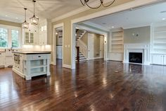 Love the Super Tall Cabinets, Extra Tall Doors, Fireplace, Legs on the Island, Sink and Open Floor Plan