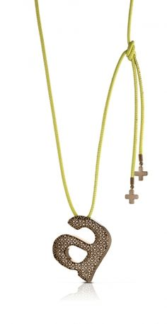 NUMBURE:  GOLD OCTANE PITAGORA    Bronze pendent with gold, pink, black and chocolate colored finish. Approximate lenght 5 cm. Made in Italy.