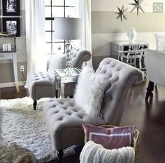 Glitz and glamour for this living room. The stars on the wall are a nice touch too! The tufted chairs are fabulous!