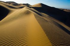 I was mesmerized watching the wind constantly changing the patterns. Huacachina Sand Dunes in Peru.