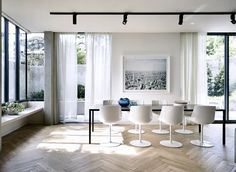 modern dining room with loads of light and herringbone floors